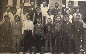 This photo was originaaly submitted to the Eganville Leader by Ella Mae Orme. Taken in the 1930's, it was the senior room at Killaloe Public School. In the front row, from left to right are, Elmer Burke, Wilmer Getz, Gordon Getz, Eldon Getz, Delroy Zummach, Alyin Layman, Russel Nass and Gordon Nass; second row, left to right, Ella Mae Potter, Alice Lisk, Myrtle Smith, Jean Weckworth, Doris Wallbridge, Irma Boland and Isabel Wallbeck; back row, left to right, Kitchener Beaton, Kenneth Chatsick, Leo Kargus, Jim McDermott, Aaron Kuehl and teacher Ted Henry. Killaloe Millennium Museum Exhibit.