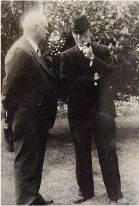 two unidentified men, one smoking a pipe