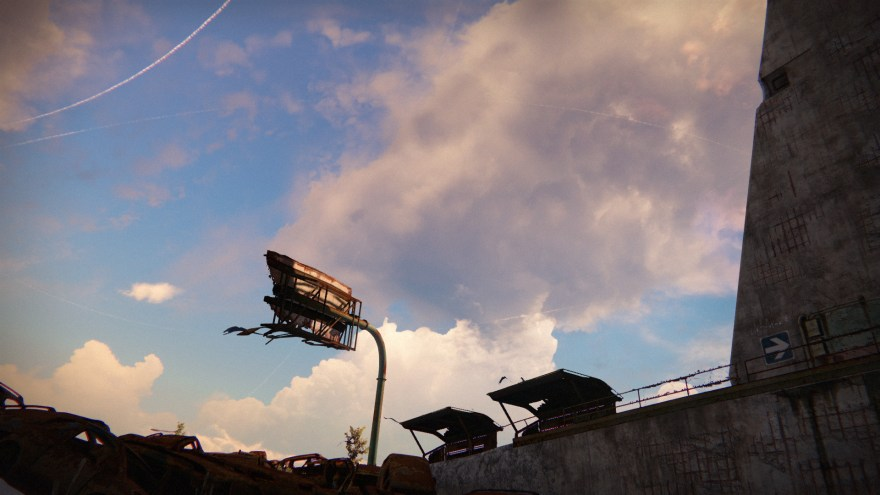 a derelict billboard against an alabaster sky