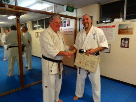 Shihan Howard Lipman awards Sensei Mark McFadden his 3rd Dan