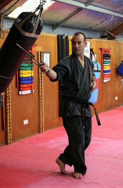 Sensei Jon Ellis with the Sai.