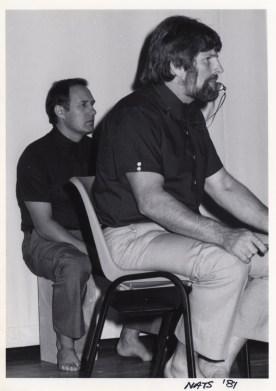 Shihan Howard Lipman (right) referees while Shihan Bob Boulton (left) watches on