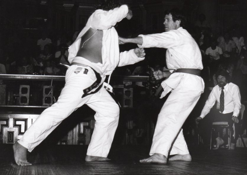 Shihan Howard (far right) referees the Final of the first AKKA National Full Contact Tournament at Sydney Town Hall in 1977, Shihan Tony Bowden v Sensei Peter Wolfe.