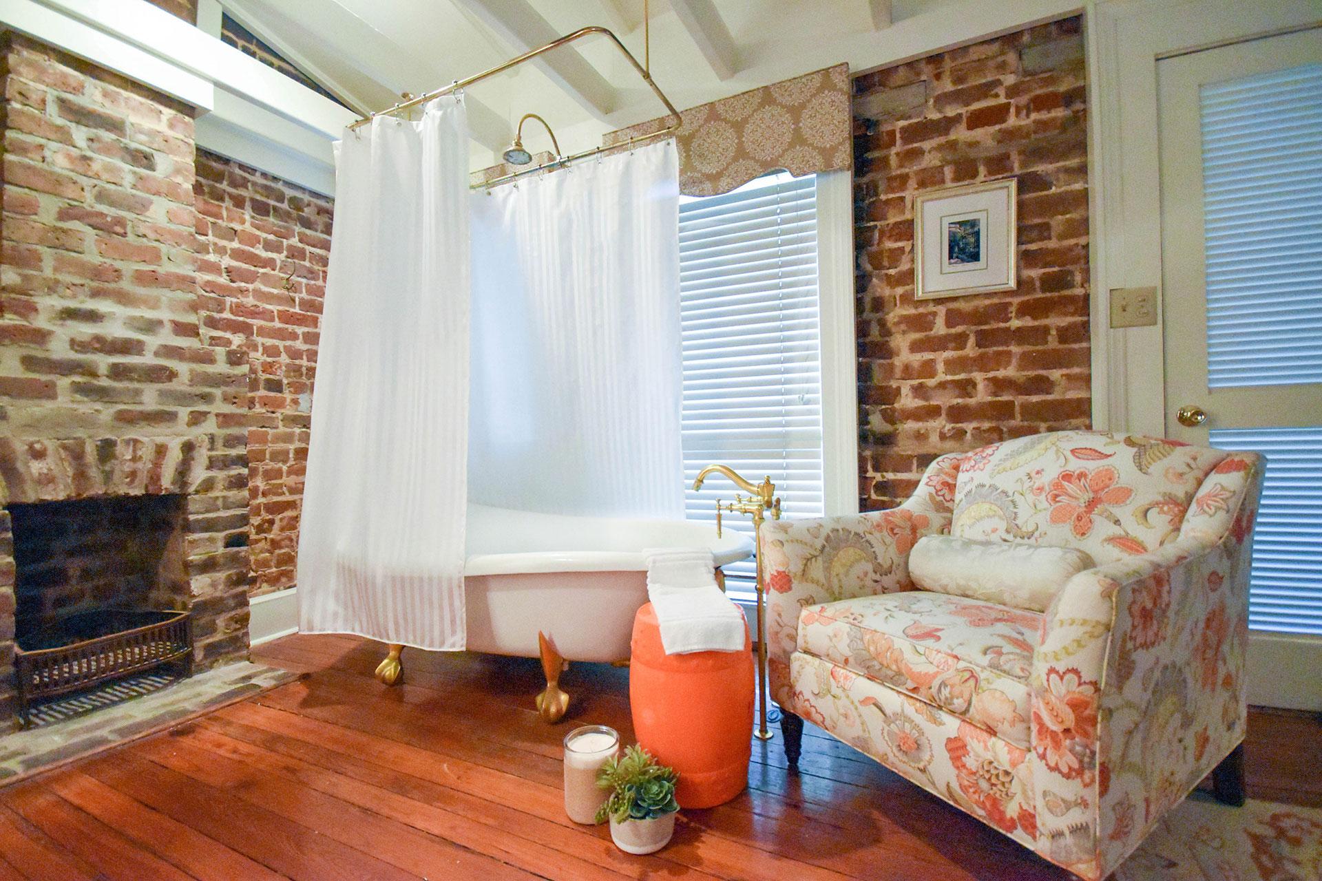 shower curtain liner over clawfoot bathtub in luxury historic inn