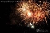 fireworks exploding and falling