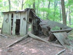 a wood structure partially collapsed