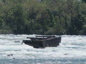 a portion of a barge in rushing water
