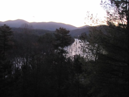Blue RIdge Lake seen from a distance, surrounded by trees, with mountains in the background