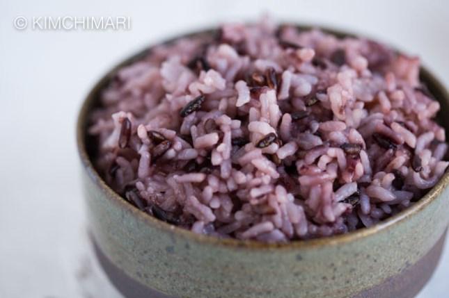 Purple Rice close up in green ceramic rice bowl