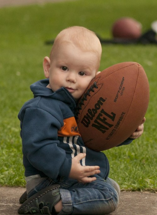 baby in possession of football