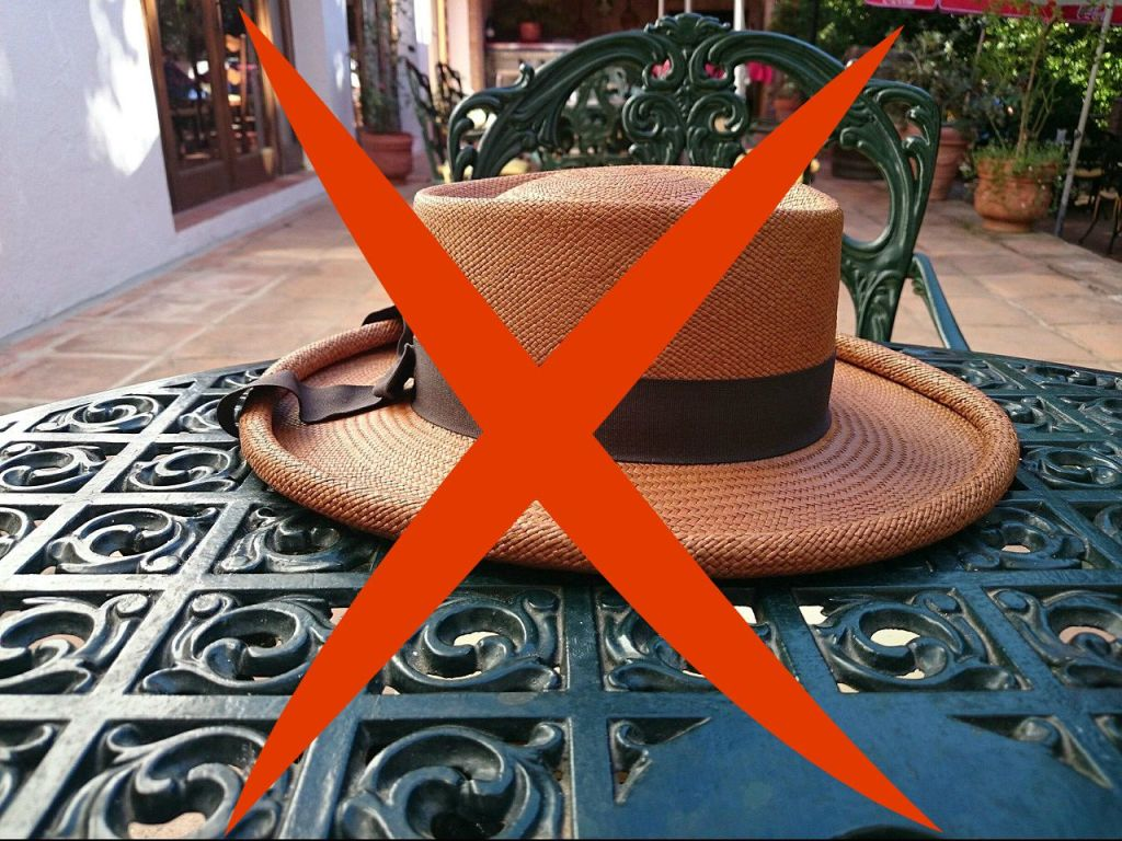 hat on table with X