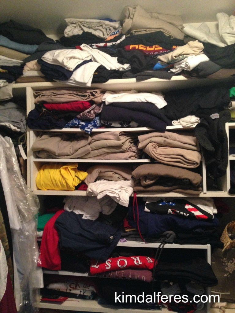 t-shirts in the closet with text
