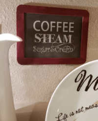 vintage chalkboard with coffee steam sugar and cream decorative words