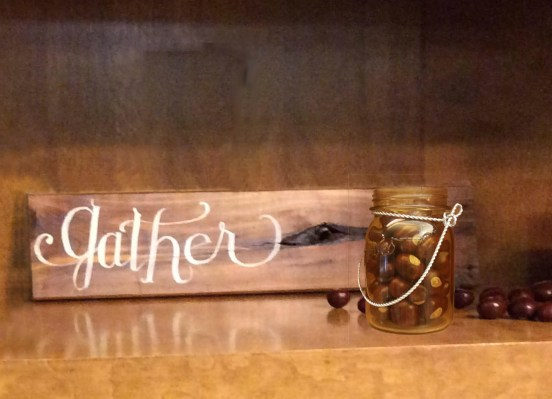 Gather lettered wood and jar of chestnuts