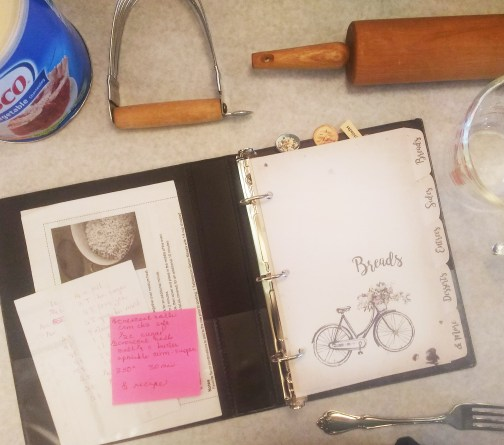 recipe book open with pie making tools