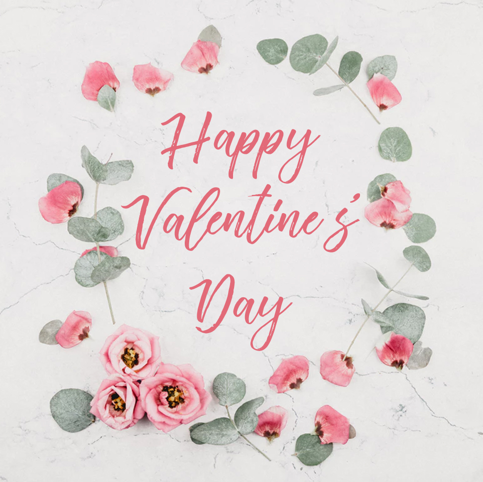 Roses-and-petals-in-flat-lay-happy-valentine's-day-words source unsplash.com