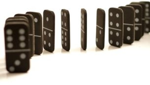 stock-footage-a-curved-set-of-black-dominoes-isolated-on-white-falling-over-starting-at-the-back-and-falling