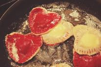 Roasted beets are a great way to add a unique flavor and fun color to our homemade pasta for Valentine's Day heart ravioli! Inside we stuffed the ravioli with a blend of Ricotta and Parmesan cheeses and a little green onion and they just melted in your mouth!