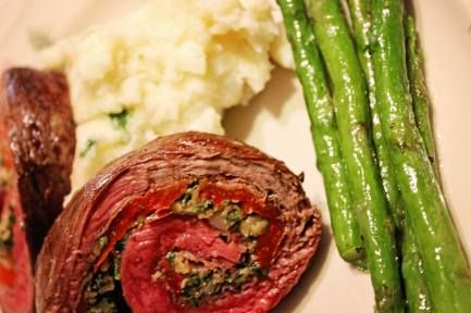 Our steak roulade, sometimes also called steak pinwheels, was a flank steak filled with prosciutto, roasted red pepper, walnut pesto and provolone cheese, then rolled up and baked until tender and juicy with all the beautiful colors on display when sliced. Our guests enjoyed this with mashed potatoes and asparagus. You can fill your roulade with whatever you fancy. A few other suggestions would be a spinach pesto, a mix of red peppers, onions and zucchini. It's nice to choose something that has color.