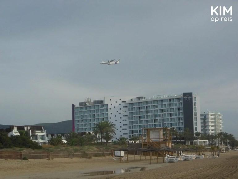 Ibiza playa d'en bossa rain: gray sky seen from the beach, a plane flies over