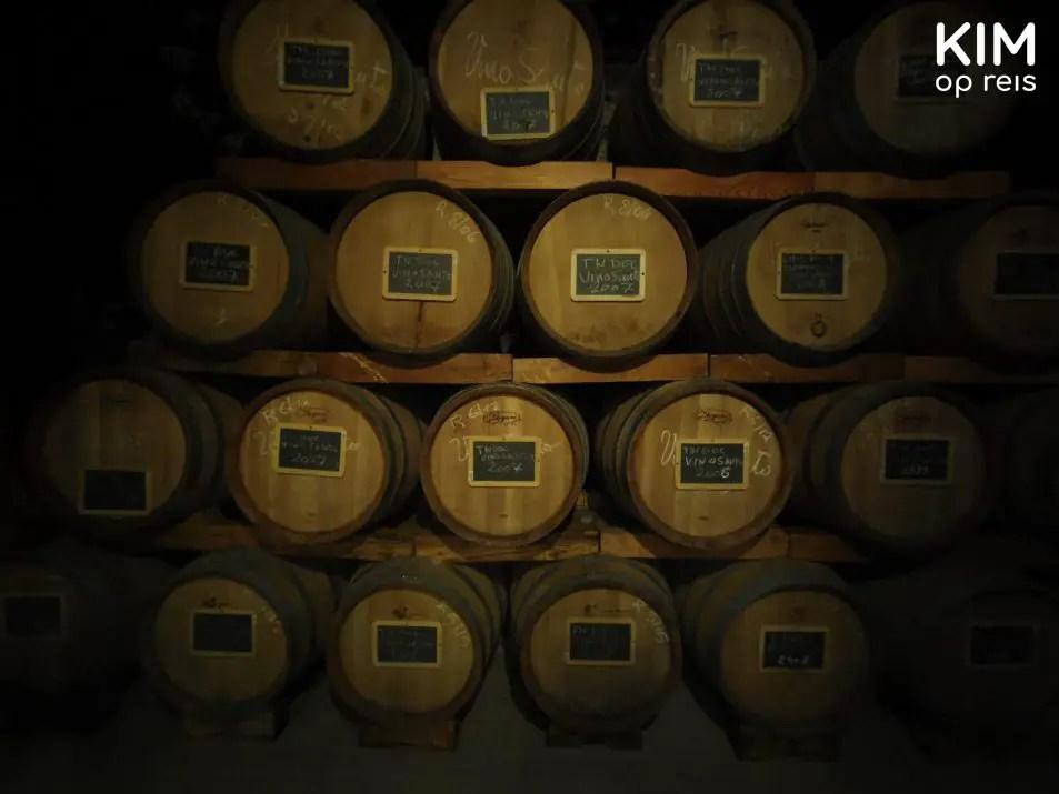 Vino Santo on barrel - dark room with wine barrels
