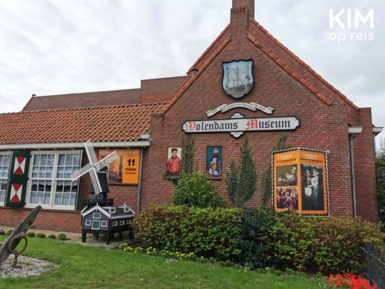 Volendam Museum - museum building with the name on the facade and some traditional objects such as a mill and paintings