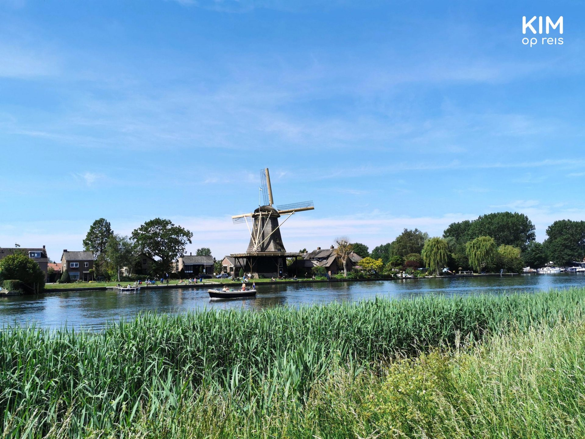 Walking along the Vecht: Mill along the river and boat on it