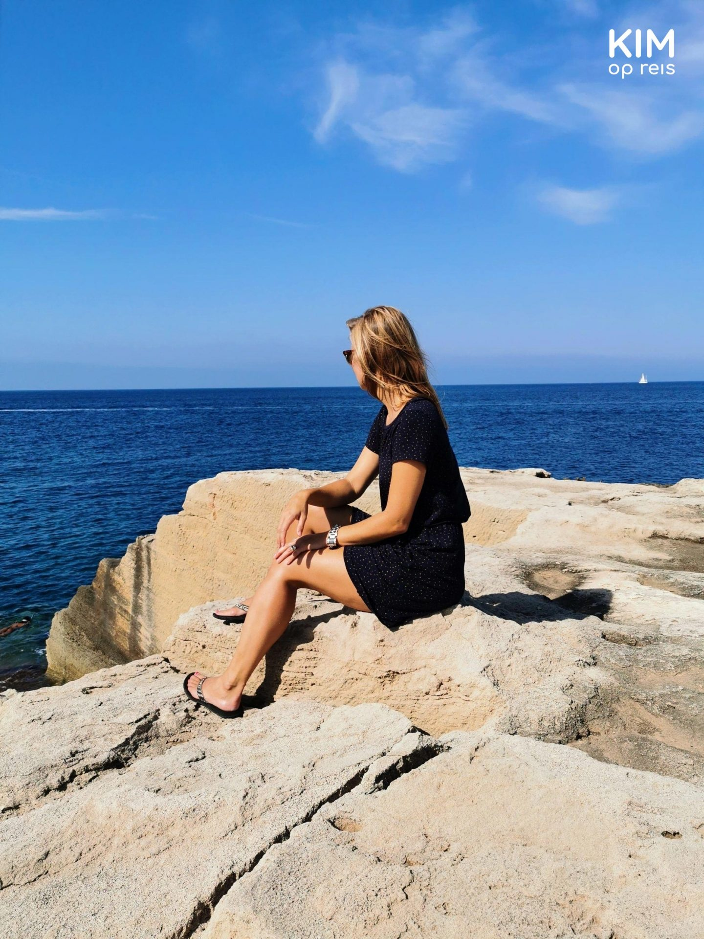 Find peace Ibiza: Kim watches the ocean from the rocks