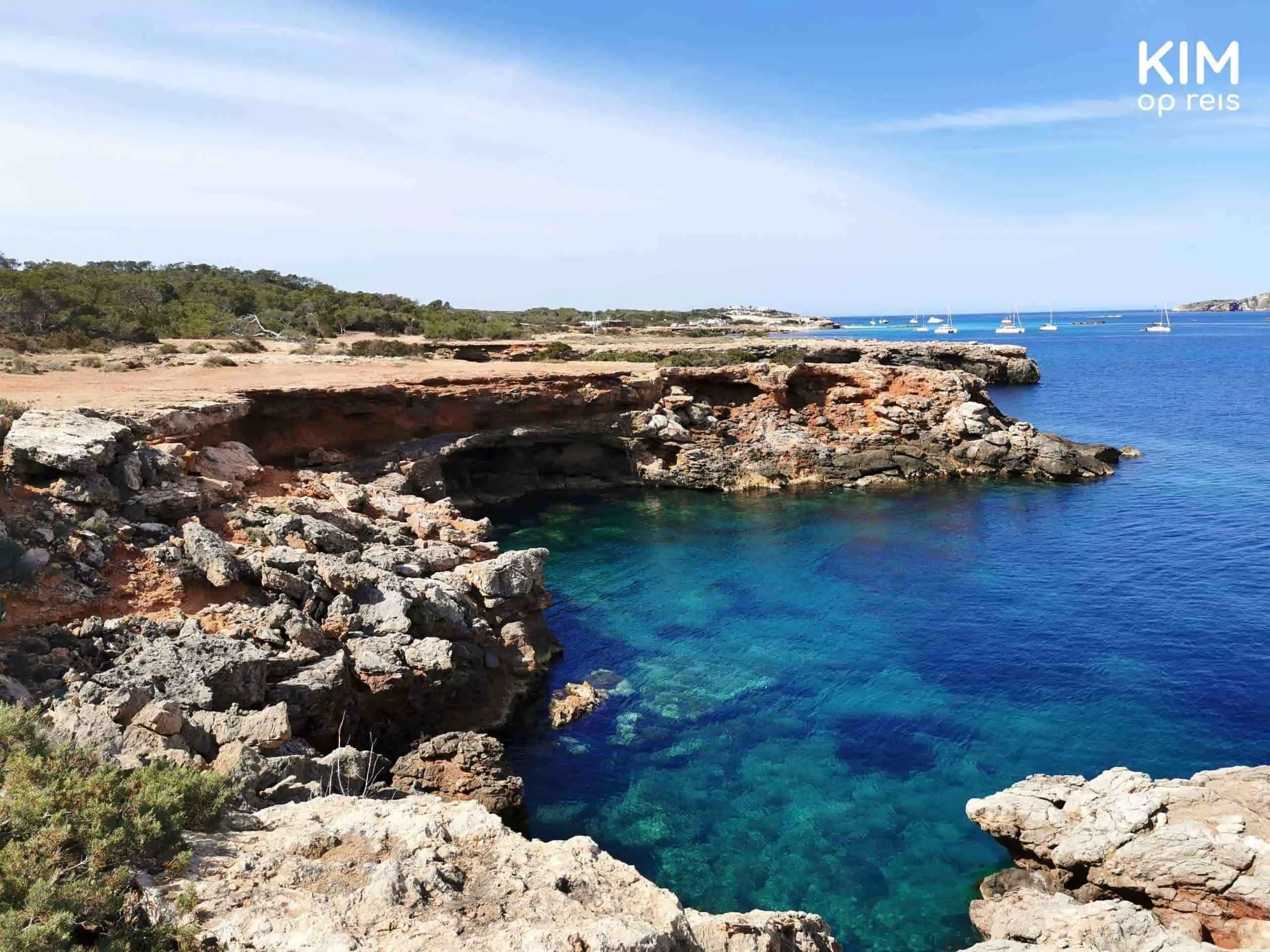 Torre d'en Rovira Ibiza rocks: clear blue bay against the rocks