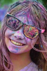 Girl smiling with colorful paint on her face