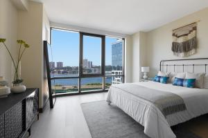 Come Check out this Stunning Apartment in a Luxury Highrise – No Fee!! photo