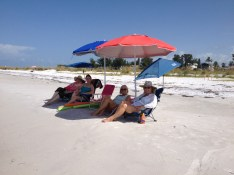 Some lovely mentor moms enjoy a lovely day on the beach.