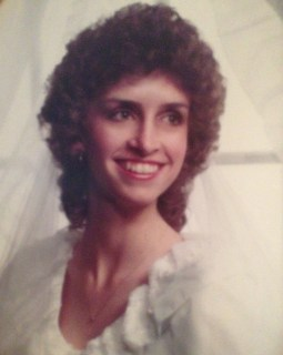 """It was the 1980's! Yes, I had the permed hair and the """"Lady Di"""" wedding dress, giant sleeves and all!"""