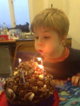 Tadpole blowing out his candles