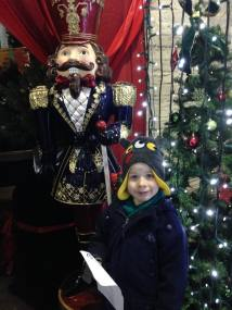 Tadpole posing with a giant nutcracker soldier