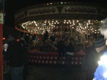 The carousel was beautiful lit up in the dark