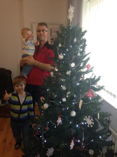All my boys together with the tree