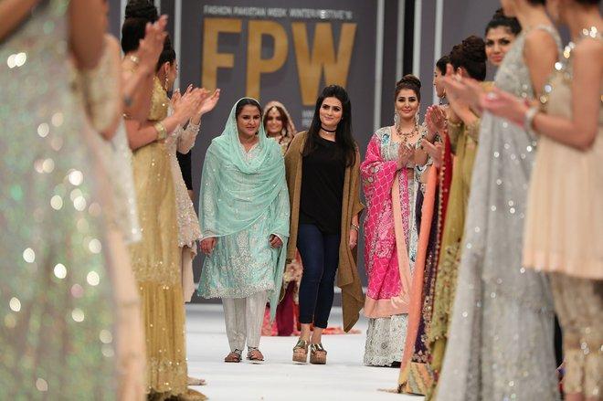 Showstopper Mukhtar Mai walking with designer Rozina Munib.