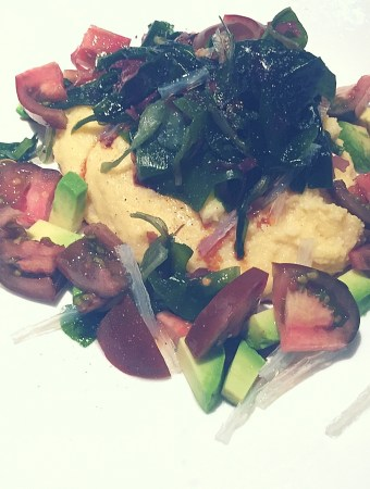 polenta with avocado tomato salad and seaweed
