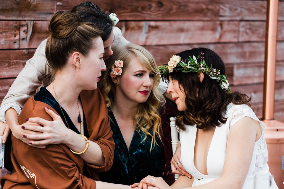 Brides shares a quiet heartfelt moment with her bridesmaids during the dinner reception