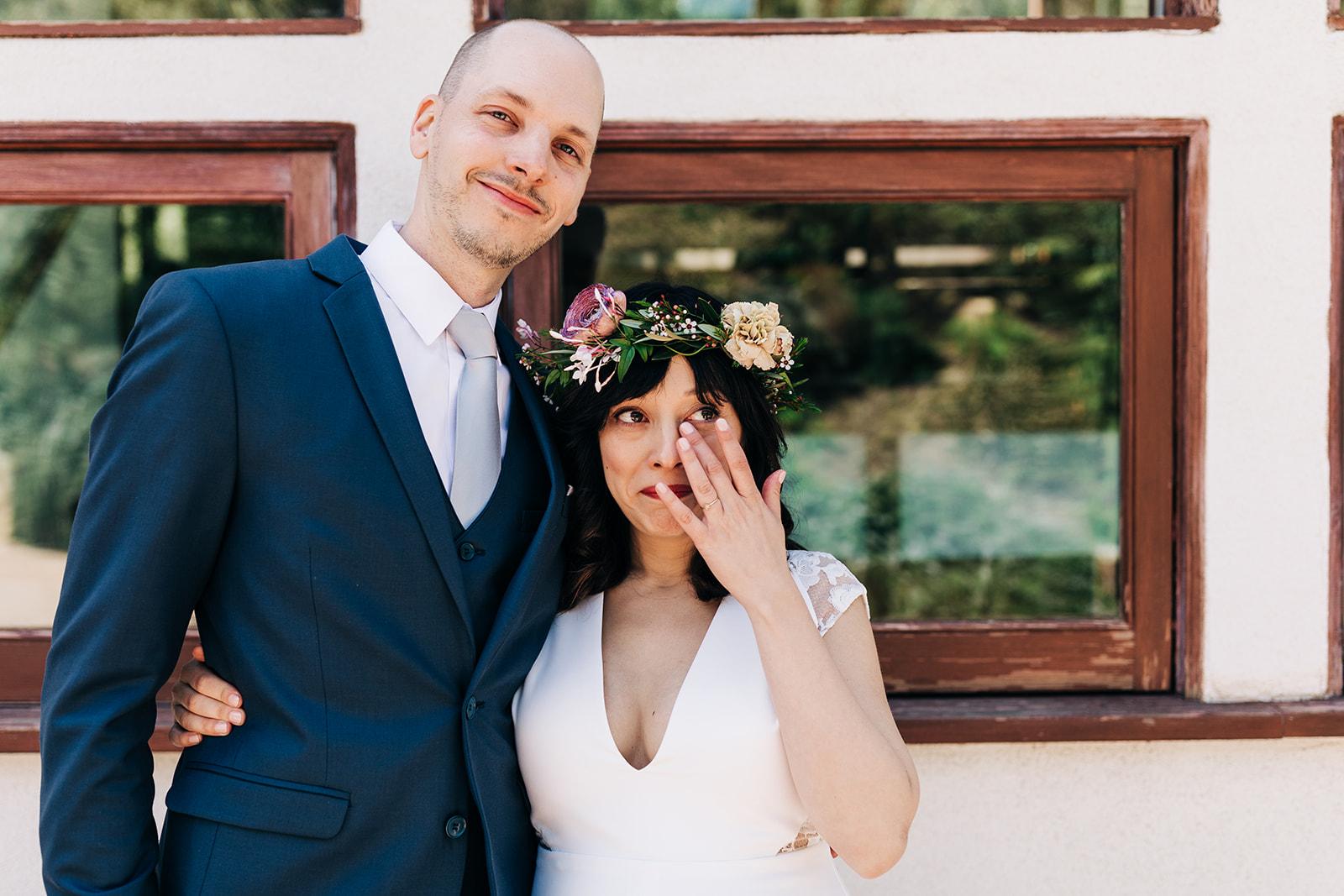 Bride wipes away happy tears