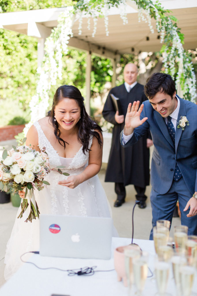 Bride and Groom greet guests on the wedding livestream
