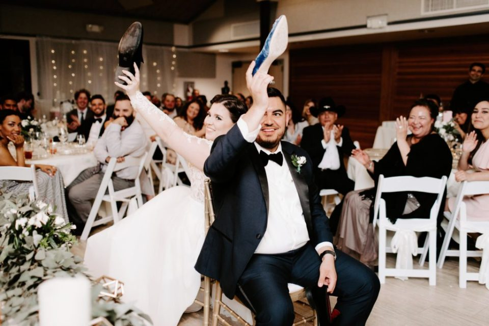 Just married couple plays the shoe game