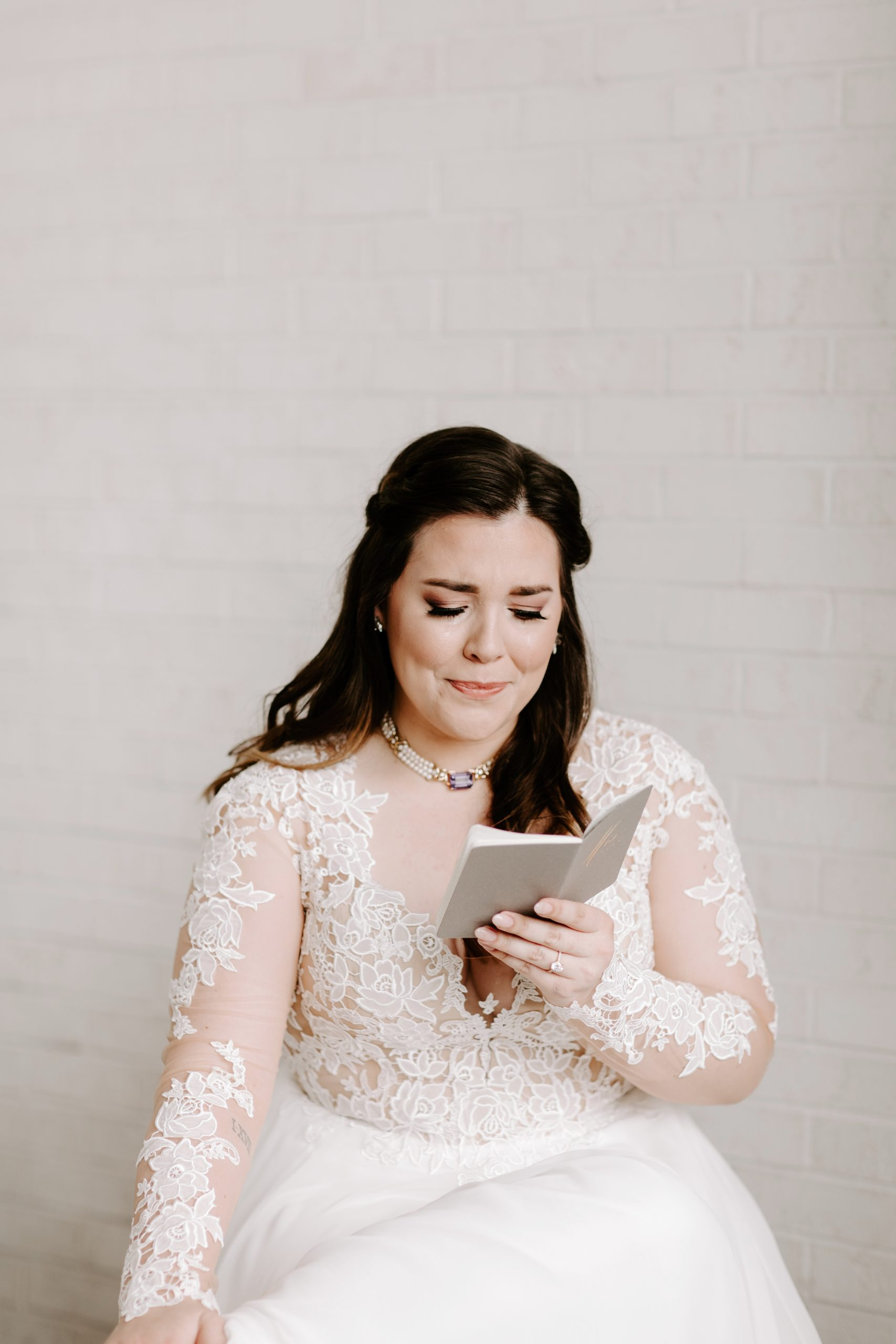 Bride crying reading grooms written vows