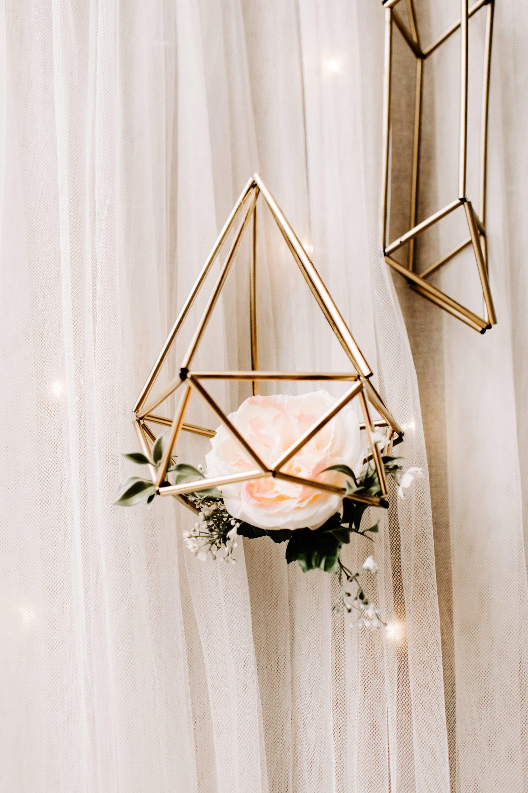Gold geometric floral decor at wedding