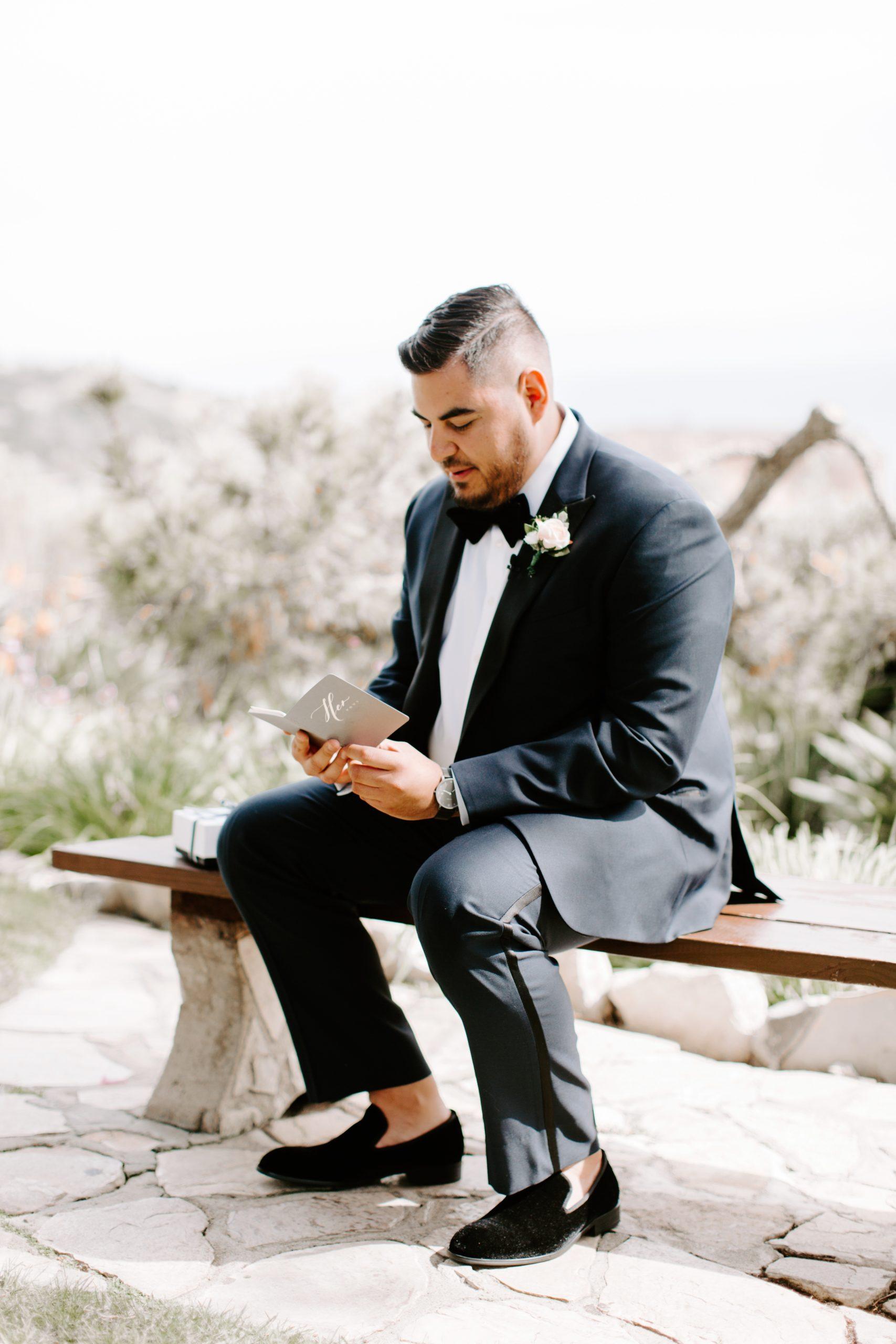 Groom reading brides written vows