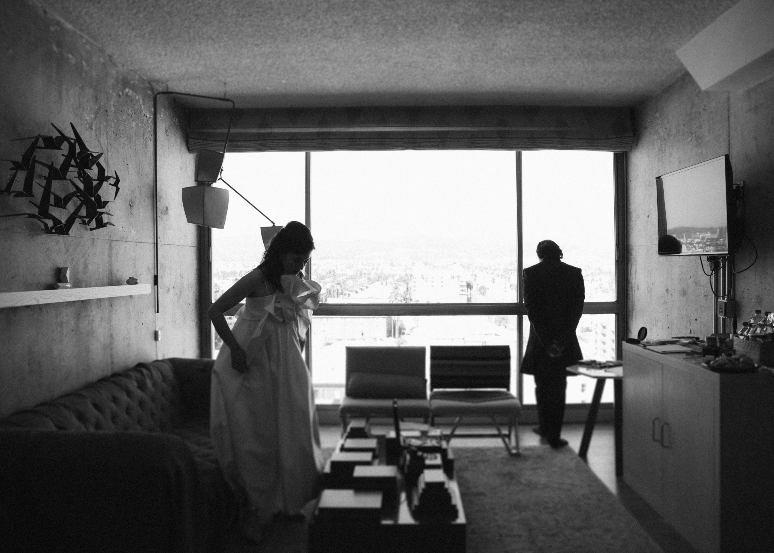 Couple getting ready in hotel room