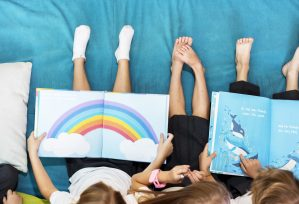 Home page banner image showing a group of diverse young students reading.