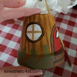 How to make a fairy house from a smalle pot. I loved this craft! I now have the perfect house for my indoor fairy garden.