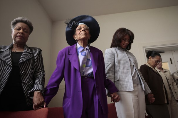 Dayna Smith/DAYNA SMITH/FTWP - Jacquelyn Hall, Ursula J. Holmes and Leslie Wiley pray during Sunday services at Nineteenth Street Baptist Church in Washington.